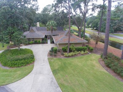 Backyard Oasis with pool, hot tub and outdoor kitchen and a fenced in backyard!