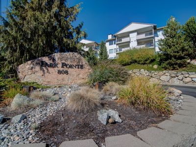 Photo for Spacious condo with a patio and great location across street from lake and park!