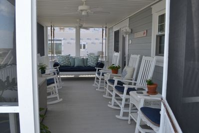 Large screened porch with custom bed swing and 6 rockers, favorite spot for many