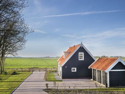 Photo for Beautiful 6-person farmhouse in the North Beveland polder landscape