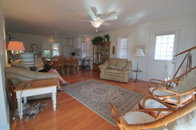 This is a picture of the living room looking into the dining room and kitchen