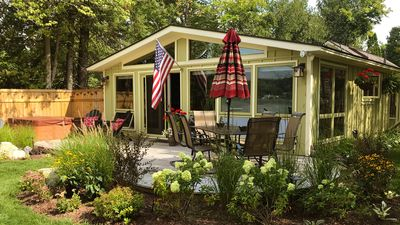 Photo for Lovely Walloon Lake Cottage w/spectacular sunsets, hot tub, hard sandy bottom
