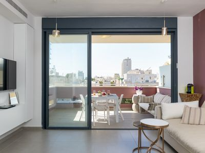 Photo for TLV OLD NORTH-STEPS TO HILTON BEACH-STYLISH APT w/ TERRACE