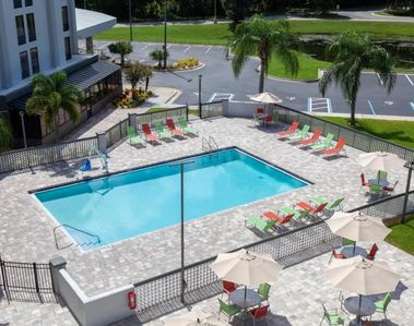 Large heated swimming pool, poolside loungers and picnic tables by the pool