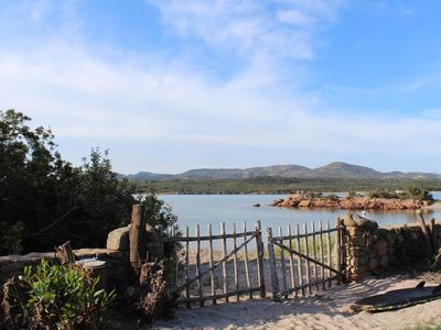 Photo for Water front, private Traditional Villa in large garden on the beach in Sardinia