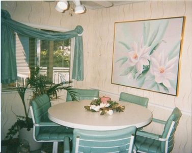 Dining area with ceiling fan very brght and airy