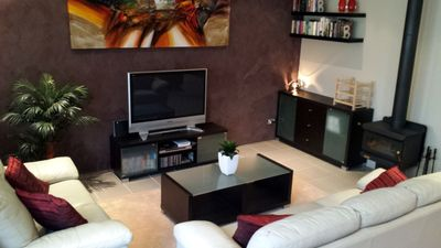 Open-plan living/dining/kitchen with fireplace for cold nights and aircon.