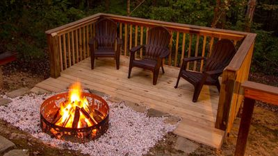 Enjoy sitting by the awesome fire pit area!  With added benches for more seating
