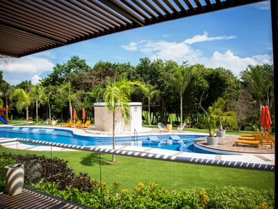 **BRAND NEW** Pool-front 2-story Luxury Condo in the heart of the Mayan Jungle