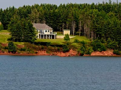 Photo for Souris Beach House right at water's edge and rated as a luxury accommodation.