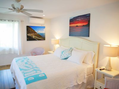 Photo for Steps to beach, sleeps 2-4. AC, heated pool, WIFI, parking, covered deck, washer