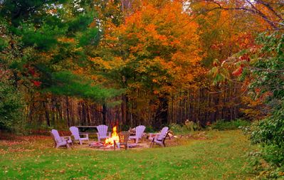 Enjoy the fall colours by the fire