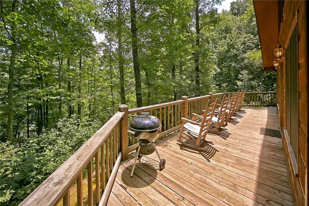 Forest serenity with a community pool fishing pond pet for Pigeon forge cabins with fishing
