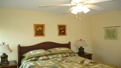 Bedroom with Queen bed, ceiling fan and AC unit