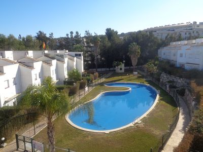 Photo for townhouse 3 hab. doubles, 2 bathrooms, kitchen equip. priv garden with bbcoa. pool pk