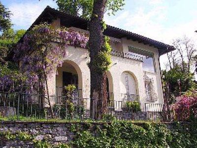 Photo for Villa on a hill with magnificent views of Lake Maggiore