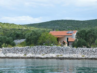 Photo for Traditional, cozy cottage by the sea on the Croatian island of Pasman