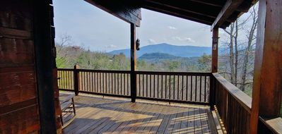 Wrap-around main deck opens to a beautiful view of Cove Mountain!