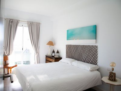 Photo for At sea level, and overlooking the beach.  Apartment with terrace and 8 hrs of sun