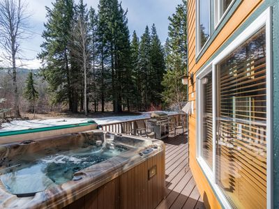 Photo for Spacious, secluded cabin w/ private hot tub on the river - dogs welcome!