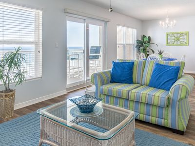 Photo for Open, airy condo, 2 beach chairs included, Close to dining