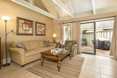 Living room with access to private patio