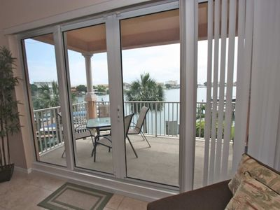 Photo for Pet friendly Waterfront, Watch Dolphins Play! Free WI-Fi & Cable, Pool, W/D – 207 Harborview Grande