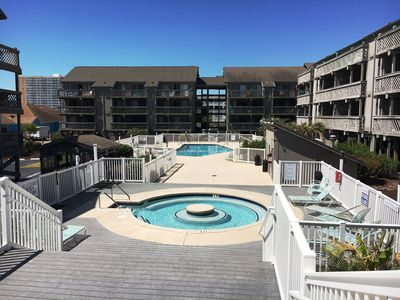 Photo for Steps to the Beach, free WIFI, hot tub, pool, 2 bedroom on Shore Drive!