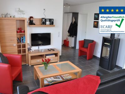 Photo for Near the beach, high quality apartment with a sauna, fireplace, beach chair and WLAN