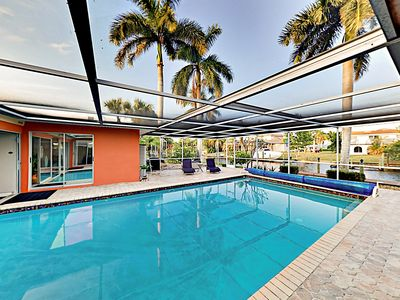 Photo for New Listing! Luxurious Canal-Side Home w/ Caged Pool, Lanai, Sauna & Dock!