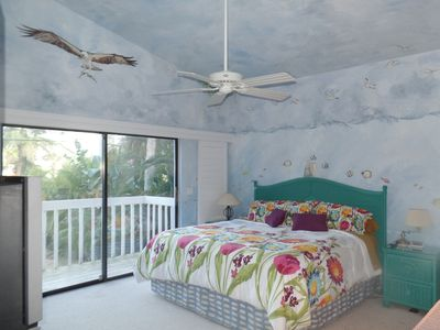 Master Bedroom Suite with private balcony. King size bed, vaulted ceiling & TV.