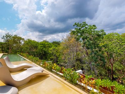 Photo for Aldea Zama's best location-jetted tub, balcony, jungle views&shared rooftop pool