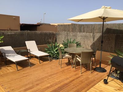 New Decking with Sun Loungers, Table and Parasol