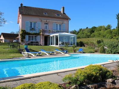 Photo for Pretty house with magnificent views of the countryside and heated pool