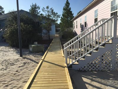 Boardwalk to the pool, tennis court and barbeque area.