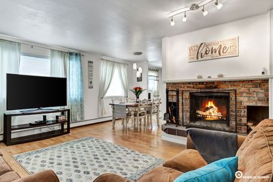 This Spacious Living Room is equipped with a Wood Burning Fireplace!