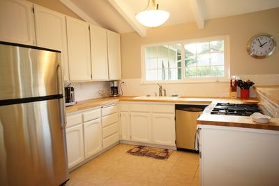 Large open kitchen with oven, 4 burner stove top, dishwasher & microwave.