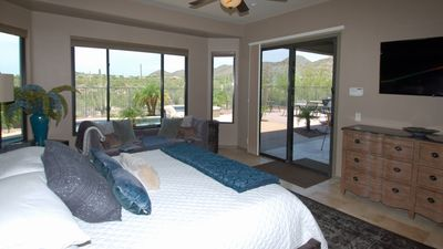 Master suite with large smart flat screen TV and pool/spa access