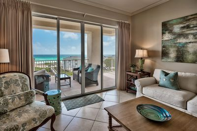 Sliding glass doors to a gulf front view - San Remo 409 is decorated to delight with a view that lets you see the dolphins swim by - and the paddle boarders, too!