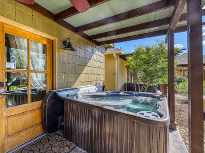 Photo for Romantic cottage with a private hot tub, on Main Street!