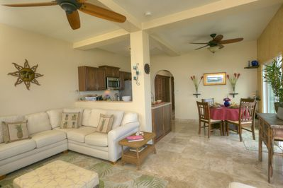 Large main living and dining area with travertine floors throughout.