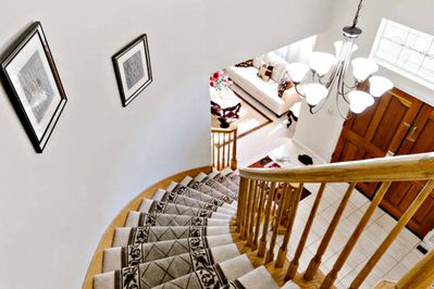 Curved stairs leading to second floor