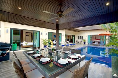 Moonstone Villa with 6 bedrooms sleeping 14 guests and offering large inside and outside dining tables, swimming pool and spacious sun deck, adjacent to the gas BBQ, ideal for Al Fresco evening dining