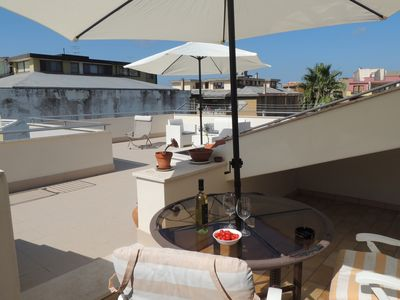 Photo for Top floor penthouse apartment with terrace in the historical center, 3 km from the beach