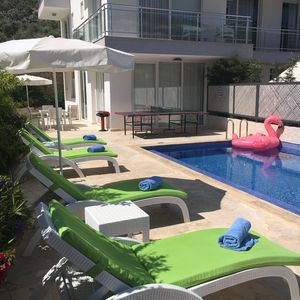 Photo for Contemporary luxury duplex apartment with large private pool in Kalkan
