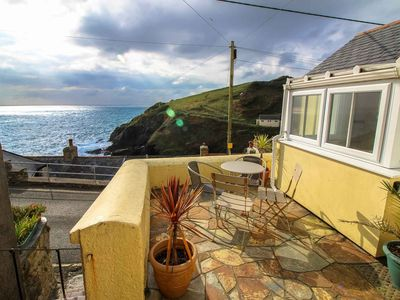 edge mid coastguards dolphin cottage a the holiday on is situated village terrace cottages former fishing details image portloe picturesque of accommodation cosy