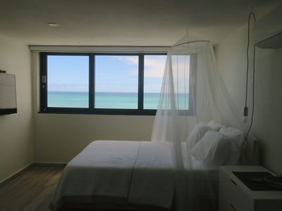 Photo for Ocean Front 2bdrms/2bath 3 beds Beach Apt Sleep 4, Private free pking, Pool WIFi