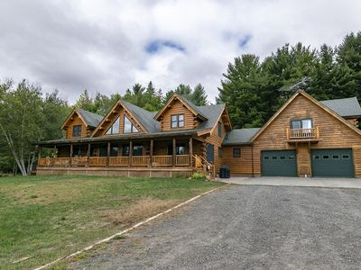Photo for Cedar Log Home sits on 41.87 private acres with mountain and meadow views