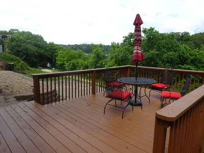 Deck and dining area with water views.