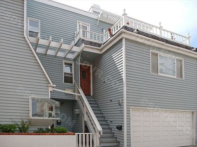 Lovely second and third story home centrally located just steps to the ocean.